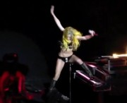 Lady GaGa falling off a piano during a concert in Houston - 4.10.11
