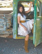 Marie Osmond - Sitting in pickup truck in dress with legs parted